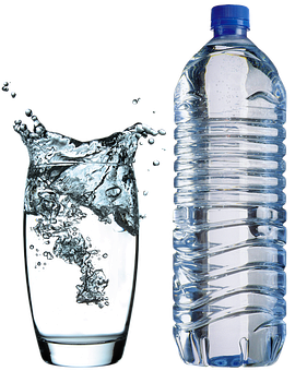 Purified and softened water in a glass and plastic bottle