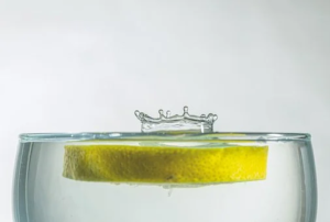 Lemon falling into purified water